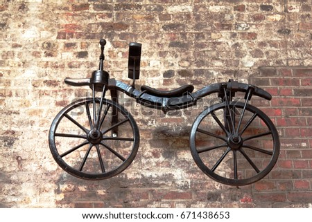 Old historic bicycle hanging on the wall