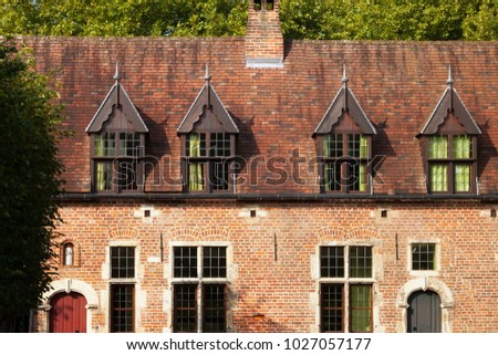 Old historic buildings in Groot Begijnhof of Leuven. Is a well preserved beguinage and completely restored historical quarter containing a dozen streets in the south of downtown Leuven, Belgium.  #1027057177