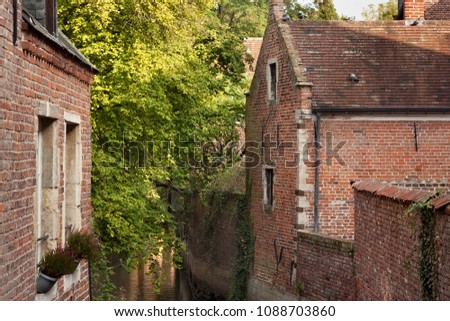 Old historic buildings in Groot Begijnhof of Leuven. Is a well preserved beguinage and completely restored historical quarter containing a dozen streets in the south of downtown Leuven, Belgium. #1088703860