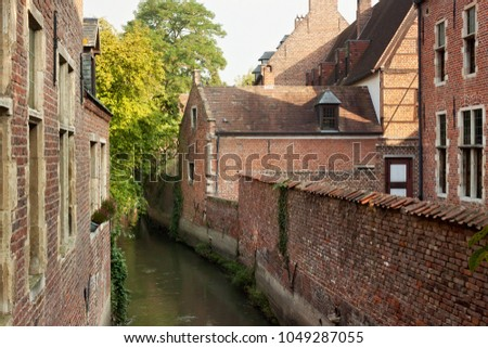 Old historic canal in Groot Begijnhof of Leuven. Is a well preserved beguinage and completely restored historical quarter containing a dozen streets in the south of downtown Leuven, Belgium. #1049287055