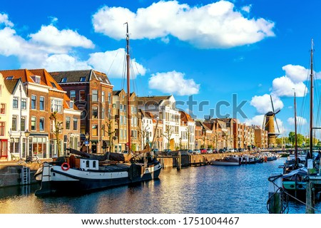 Old historic district Delfshaven with wildmill and houseboats in Rotterdam, South Holland, The Netherlands. Summer sunny day Stockfoto ©