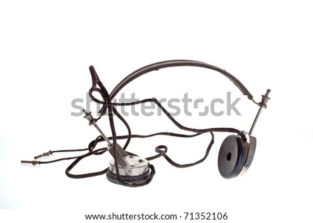 old historic headphone on white background