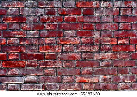 Old historic house grunge brick wall with bright red bricks and paint film