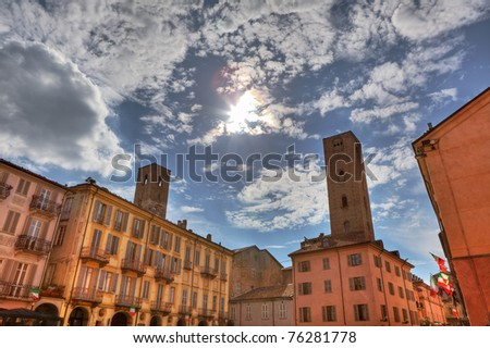 Old historic houses and ancient towers of Alba in Piedmont, northern Italy.
