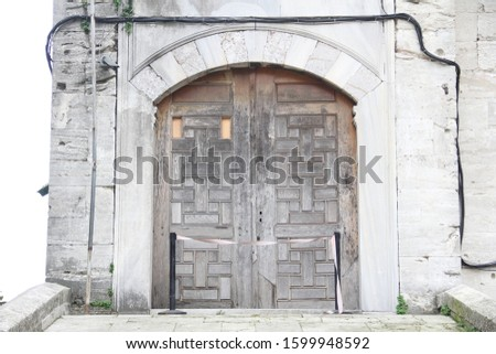 old historical historic wooden door with stone wall