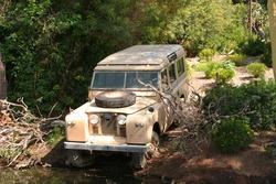 Old historical safari jeep at the shore.
