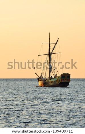 old historical sail ship at the sunset