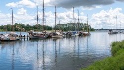 Old historical sailing boats in the harbor of Kappeln in Schleswig-Holstein, Germany