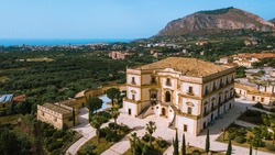 Old historical villa in a small Italian town, famous landmark in Sicily, aerial view of a Sicilian town Bagheria with Villa Cattolica