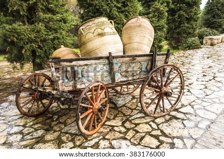 Old broken cart wheels and axle Images and Stock Photos