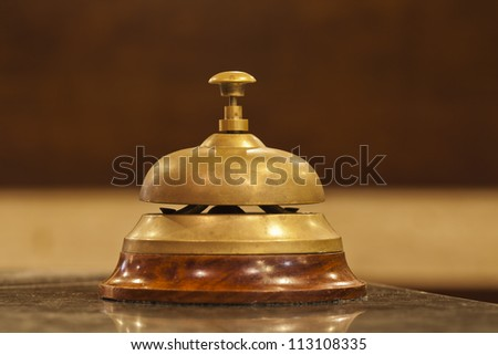 old hotel bell on a wood stand