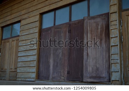Old house along Mekong river, Chiang Khan district, Loei Province, Thailand, made of wood, windows and walls covered with wooden slats in retro and old-fasioned style design going well with atmoshere #1254009805