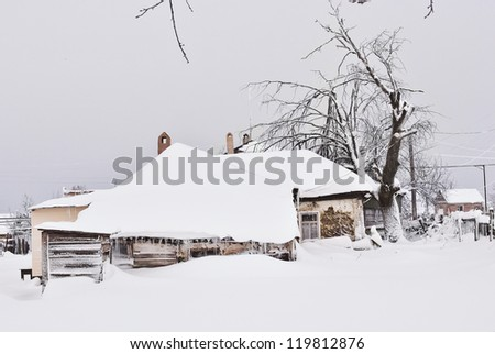 Old House and Tree Under the Snow - stock photo