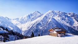 old house at the european alps in winter