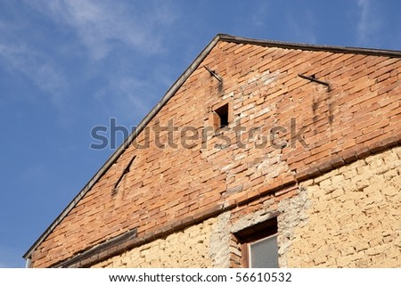 Old house gable - bricks and clamps