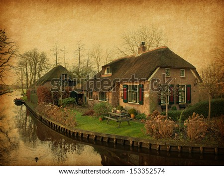 Old  house in Giethoorn, Netherlands. Photo in retro style. Added paper texture.