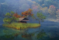 old house on a small island  in the dream lake