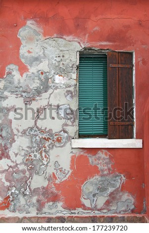 Old house red wall with wooden window