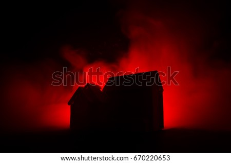 Stock Photo Old house with a Ghost in the moonlit night or Abandoned Haunted Horror House in fog. Old mystic villa with surreal big full moon. Horror Halloween concept.