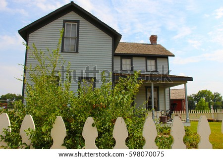 Old house with a white picket fence
