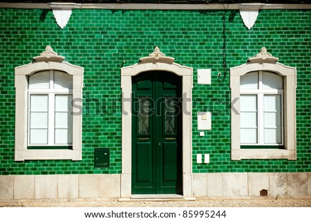 Old house with green tiles on facade