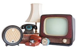 Old household items: TV, radio, camera, alarm, phone, table lamp, suitcase.   Old household items isolated on white background.