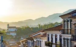 Old houses and churches in colonial architecture from the 18th century in the historic city of Ouro Preto in Minas Gerais, Brazil at sunset
