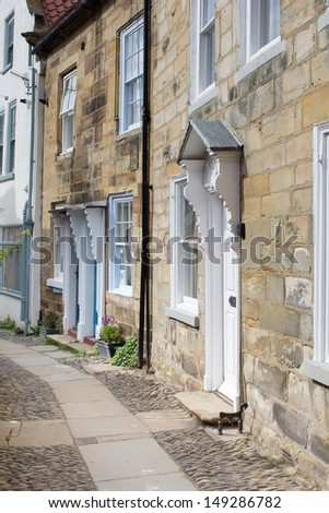 Old houses and street in Robin Hood's Bay - small coastal town in Yorkshire, England