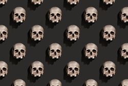 Old human skull with shadow on black background abstract pattern