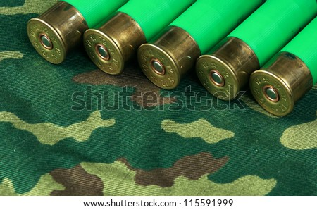 Old hunting cartridges on camouflage background