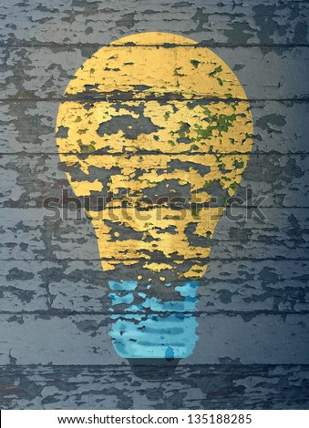 Old ideas that are out of favor or forgotten concepts that are no longer popular represented by old wooden planks with flaking and fading paint with a light bulb painted on the rustic used boards.