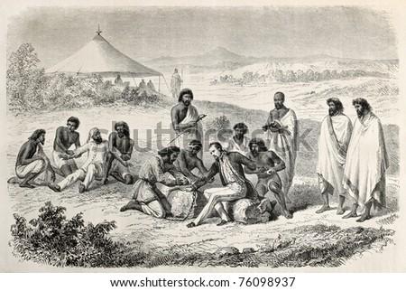 Old illustration of Guillaume Lejan arrest by order of  Emperor Tewodros.  Created by Janet-Lange and Trichon, after sketch of Lejean, published on Le Tour du Monde, Paris, 1864 - stock photo
