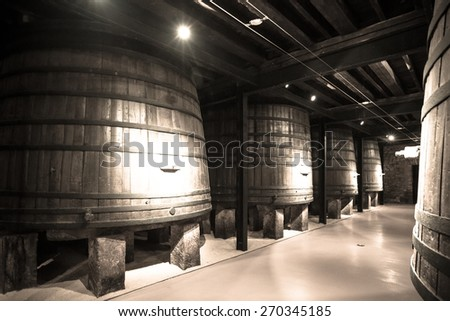 Old image  of  winery  with  wooden barrels