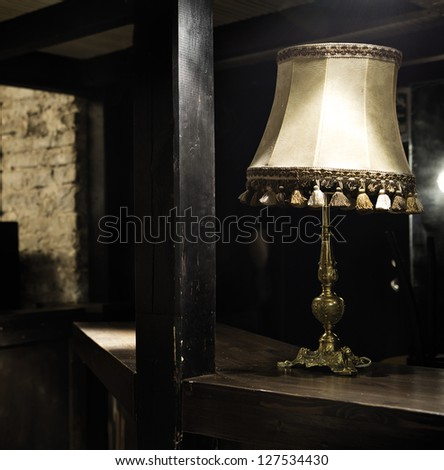 Old in retro style lamp lightning dark room