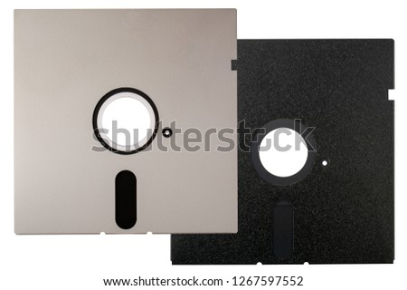 Old 5.25 inch Floppy Disks, data storage, isolated on white backgrounds