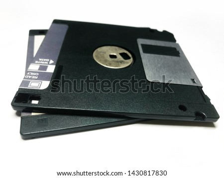 Old 3.5-inch floppy disks on the white background. #1430817830
