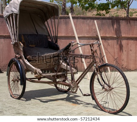Old indian bicycle with cart in the yard