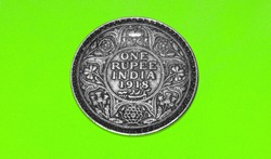 Old Indian One Rupee coin 1918 or Currency ( Written One  Rupee India 1918 on it ) ON Chroma or Green Background
