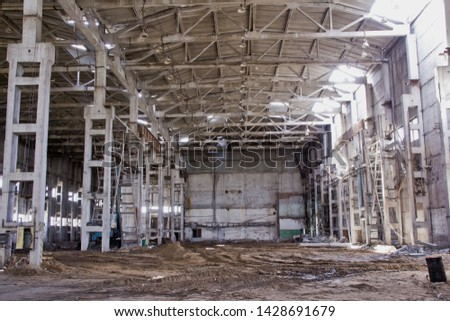 Old industrial building. Abandoned production. Demolition work of an old industrial building.
