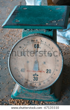 Old industrial rice scales on dustry warehouse floor