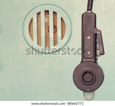 old industrial speaker and microphone on green background