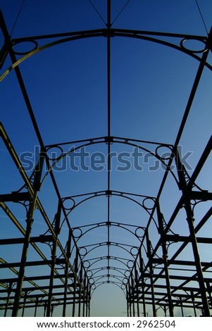old industrial steel structure against blue sky