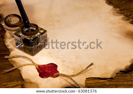 Old ink pot on a parchment scroll with wax seal