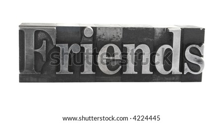 old, ink-stained metal letterpress type spells out the word 'Friends' isolated on white
