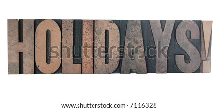 old, ink-stained wood letters spell out the word 'holidays!' in all caps isolated on white