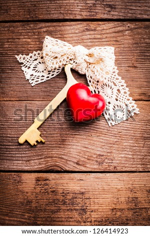 Old intage key and red heart. Key of my heart concept. Valentine's day greetings.
