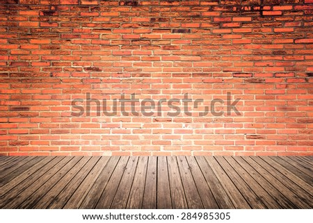 Old interior room with broken red brick wall and grunge wood floor texture