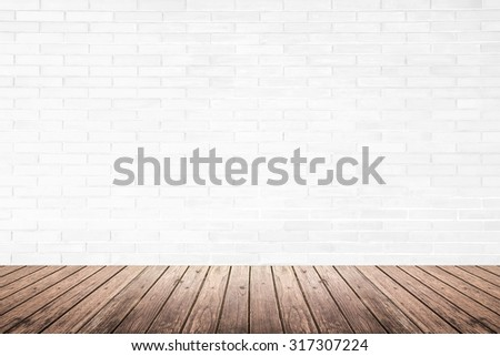 Old interior room with white brick wall texture and brown grunge wood floor pattern, use for background, backdrop or design element