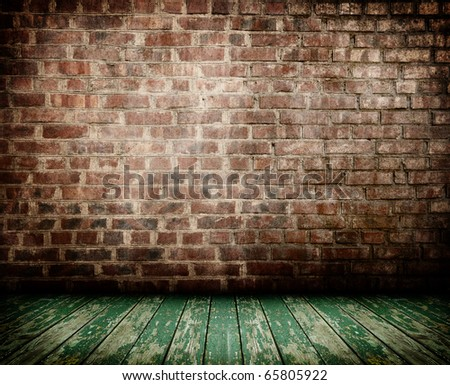 old interior with brick wall and wooden floor
