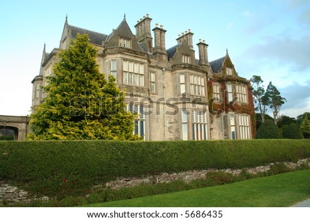Old Irish estate house and gardens - stock photo